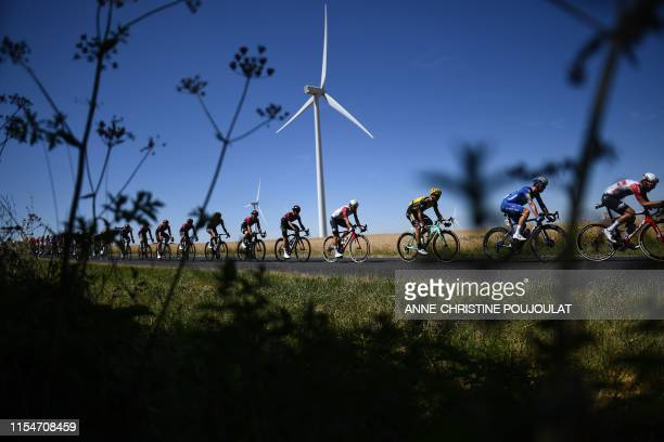 The pack rides during the fourth stage of the 106th edition of the Tour de France cycling race between Reims and Nancy, eastern France, on July 9,...