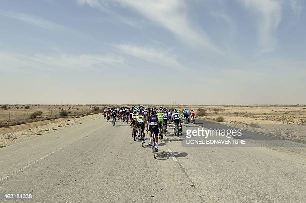 The pack rides during the fourth stage of the 2015 Tour of Qatar, between al-Thakhira and Mesaieed on February 11, 2015. Dutch rider Niki Terpstra of...