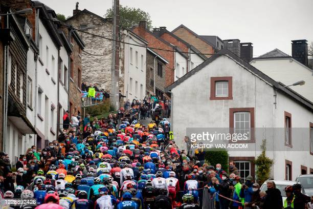 The pack rides during the Liege-Bastogne-Liege one day cycling race in Liege, on October 4, 2020 in Liege. / Belgium OUT