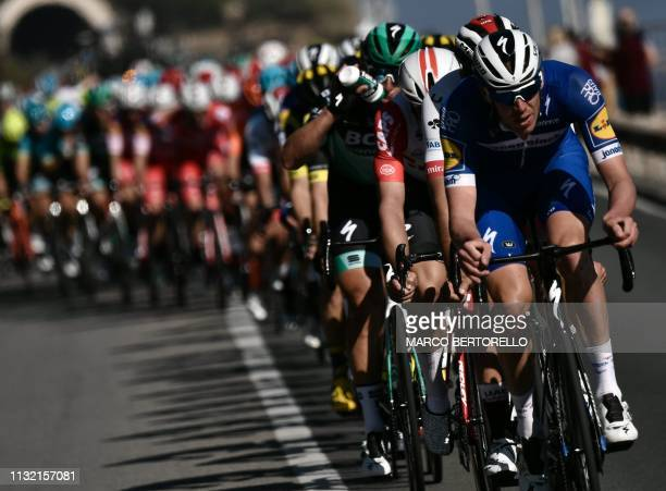The pack rides during the oneday classic cycling race Milan San Remo on March 23 2019