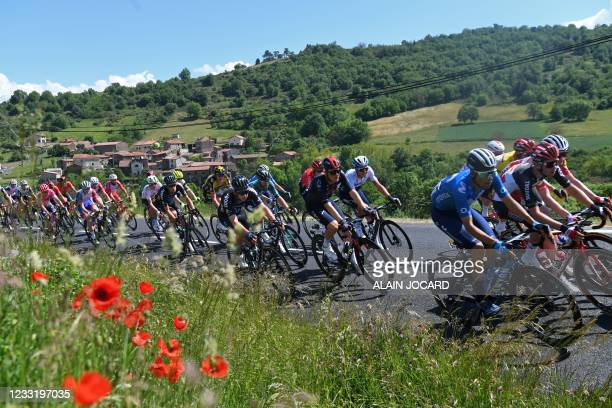 The pack rides during the second stage of the 73rd edition of the Criterium du Dauphine cycling race, 173km between Brioude and Saugues on May 31,...