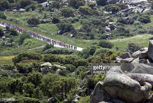 The pack rides during the second stage of the Giro d'Italia cycling race 206 km leg from Tempio Pausania to Bosa on the Italian Island of Sardinia 13...