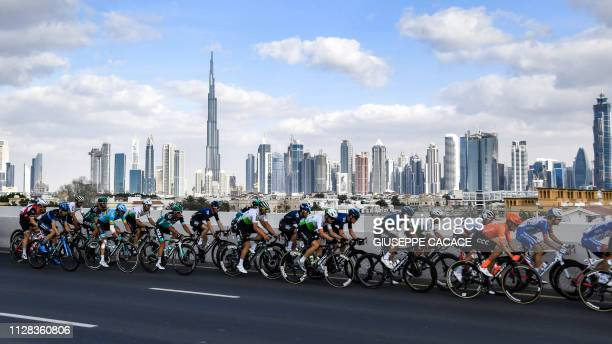 TOPSHOT The pack rides during the seventh stage of the UAE tour in Dubai on March 2 2019