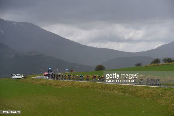 The pack rides during the sixth stage of the Giro d'Italia 2021 cycling race, 160 km between Grotte di Frasassi and Ascoli Piceno on May 13, 2021.
