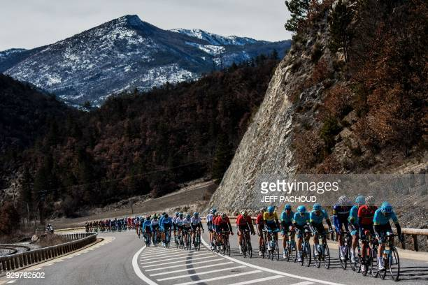 The pack rides during the sixth stage of the Paris Nice cycling race between Sisteron and Vence on March 9 2018 / AFP PHOTO / JEFF PACHOUD