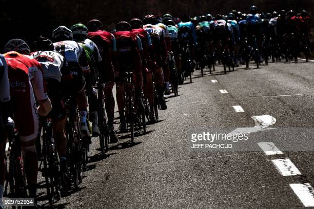 TOPSHOT The pack rides during the sixth stage of the ParisNice cycling race between Sisteron and Vence on March 9 2018 in Vence / AFP PHOTO / JEFF...