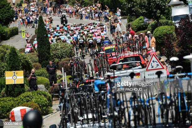 The pack rides during the tenth stage of the 105th edition of the Tour de France cycling race between Annecy and Le Grand-Bornand, French Alps, on...