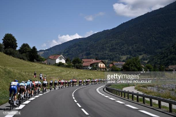 The pack rides during the third stage of the 72nd edition of the Criterium du Dauphine cycling race, 157 km between Corenc and...