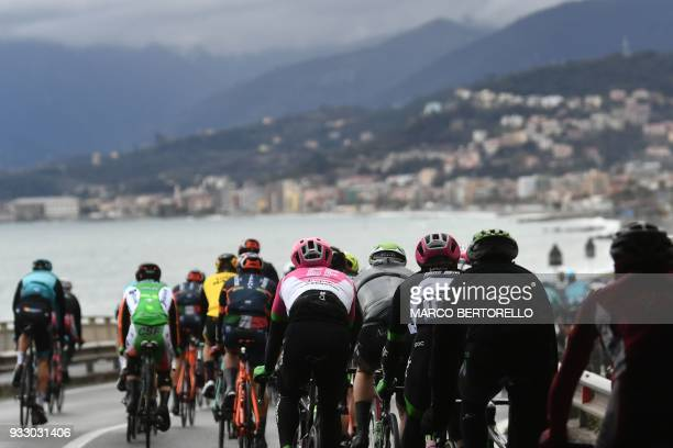 The pack rides in Borgio Verezzi during the 109th Milan San Remo cycling race on March 17 2018 / AFP PHOTO / Marco BERTORELLO