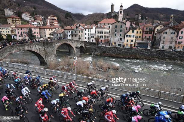 The pack rides in Campo Ligure during the 109th edition of the Milan San Remo cycling race on March 17 2018 / AFP PHOTO / Marco BERTORELLO