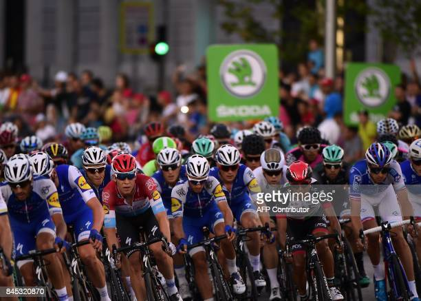 The pack rides in Madrid during the 21th and last stage of the 72nd edition of 'La Vuelta' Tour of Spain cycling race a 1176 km route from...