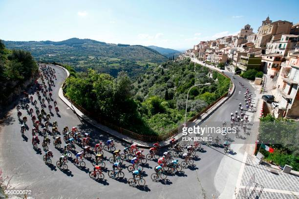 TOPSHOT The pack rides in Monterosso Almo during the 4th stage between Catania and Caltagirone of the 101st Giro d'Italia Tour of Italy cycling race...