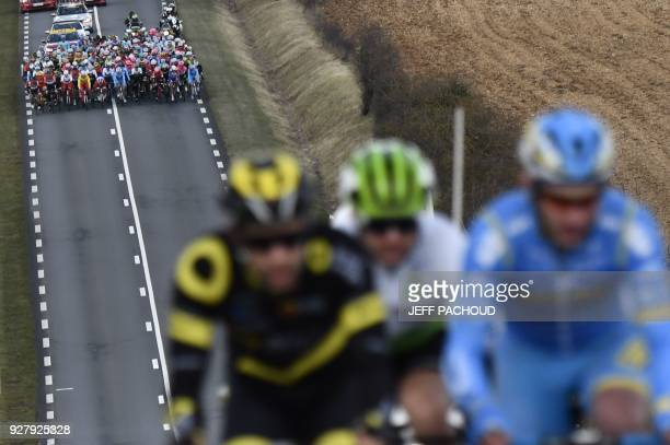 TOPSHOT The pack rides in pursuit of a threemen breakaway Direct Energie French rider Fabien Grellier Dimension Data South African rider Jay Thomson...