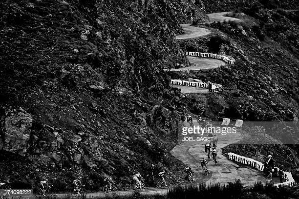 The pack rides in the Col de Sarenne during the 1725 km eighteenth stage of the 100th edition of the Tour de France cycling race on July 18 2013...