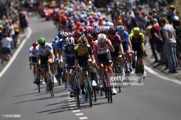 TOPSHOT The pack rides in the first stage of the 106th edition of the Tour de France cycling race between Brussels and Brussels Belgium on July 6 2019