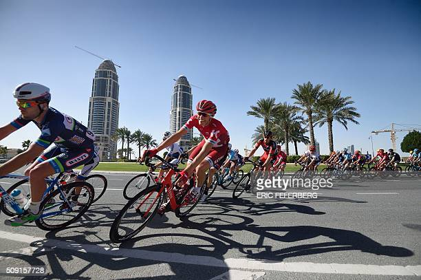 The pack rides in the Pearl Corniche district in Doha during the second stage of the 2016 Tour of Qatar cycling race starting and finishing at the...