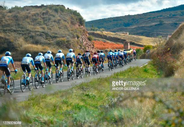 The pack rides in Ventosa during the 8th stage of the 2020 La Vuelta cycling tour of Spain, a 164 km race from Logrono to Alto de Moncalvillo, on...