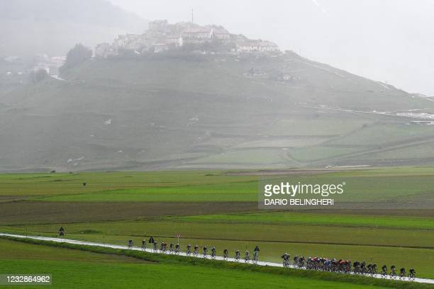 The pack rides near Castelluccio di Norcia during the sixth stage of the Giro d'Italia 2021 cycling race, 160 km between Grotte di Frasassi and...