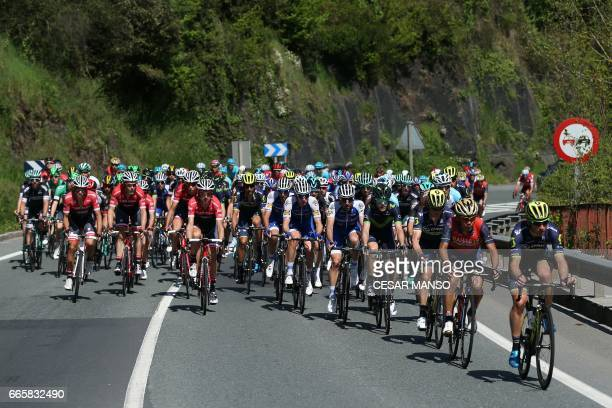 The pack rides near Eibar on April 7 2017 during the fifth stage of the 2017 Tour of the Basque country a 1398km route between Bilbao and Eibar / AFP...