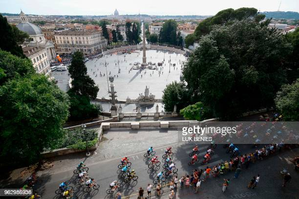 The pack rides near Piazza del Popolo during the 21st and last stage of the 101st Giro d'Italia Tour of Italy cycling race on May 27 2018 in Rome