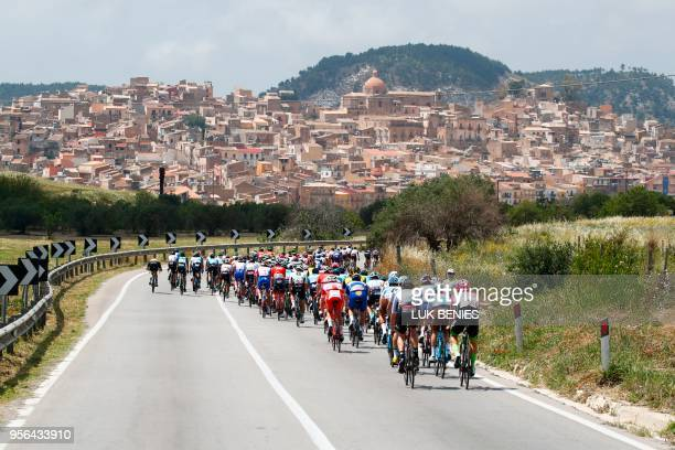 TOPSHOT The pack rides near Siculiana during the 5th stage between Agrigento and Stanta Ninfa during the 101st Giro d'Italia Tour of Italy cycling...