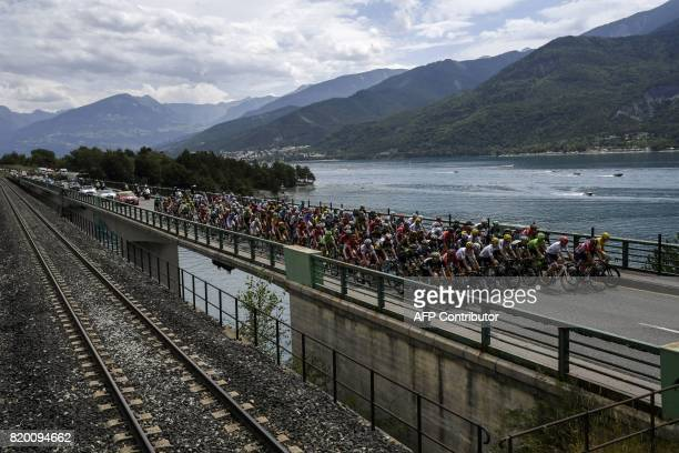 The pack rides on a bridge past a lake during the 2225 km nineteenth stage of the 104th edition of the Tour de France cycling race on July 21 2017...