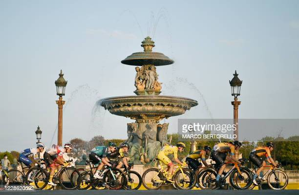 The pack rides on Concorde square during the 21st and last stage of the 107th edition of the Tour de France cycling race, 122 km between...