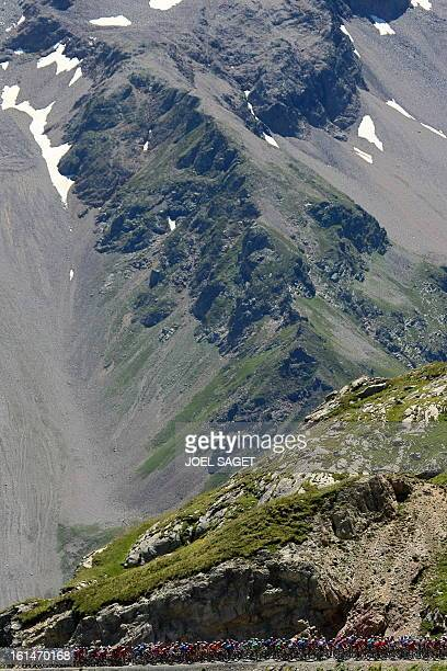 The pack rides on July 23 during the 2105 km seventeenth stage of the 2008 Tour de France cycling race run between Embrun and L'Alpe d'Huez Spanish...