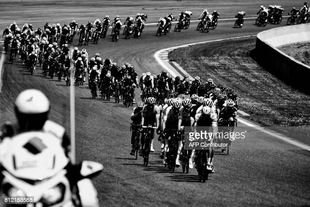 The pack rides on the Circuit de SpaFrancorchamps motorracing circuit during the 2125 km third stage of the 104th edition of the Tour de France...