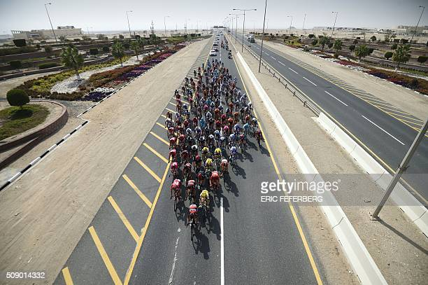 The pack rides on the highway during the first stage of the 2016 Tour of Qatar, between Dukhan and Al Khor Corniche on February 8, 2016. Britain's...
