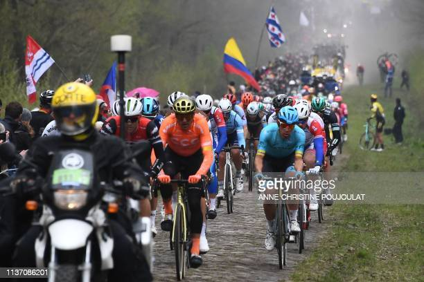 The pack rides on the Trouee d'Arenberg cobbled stones sector during the 117th edition of the ParisRoubaix oneday classic cycling race between...