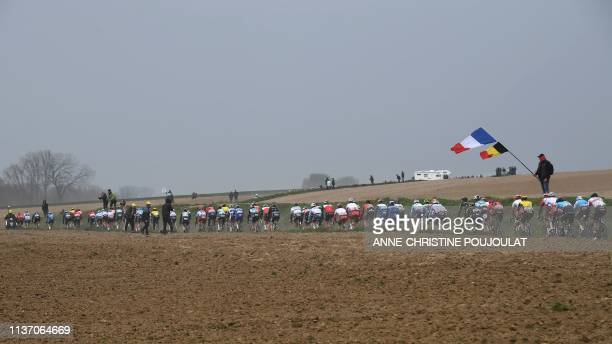 The pack rides on the Vertain to Saint-Martin-sur-Ecaillon cobbled stones sector during the 117th edition of the Paris-Roubaix one-day classic...