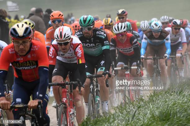 The pack rides on the Vertain to SaintMartinsurEcaillon cobbled stones sector during the 117th edition of the ParisRoubaix oneday classic cycling...