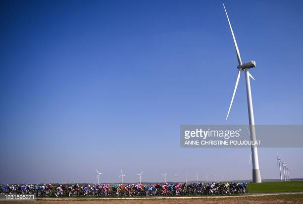 The pack rides past a wind farm during the 2nd stage of the 79th Paris - Nice cycling race, 188 km between Oinville-sur-Montcent and Amilly, on March...