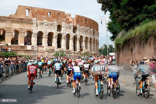 The pack rides past the ancient Colosseum during the 21st and last stage of the 101st Giro d'Italia, Tour of Italy cycling race, on May 27, 2018 in...