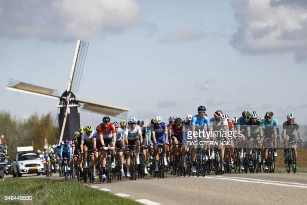TOPSHOT The pack rides past the Hubertus mill during the Amstel Gold Race in Beek on April 15 2018 / AFP PHOTO / ANP / Bas Czerwinski / Netherlands...