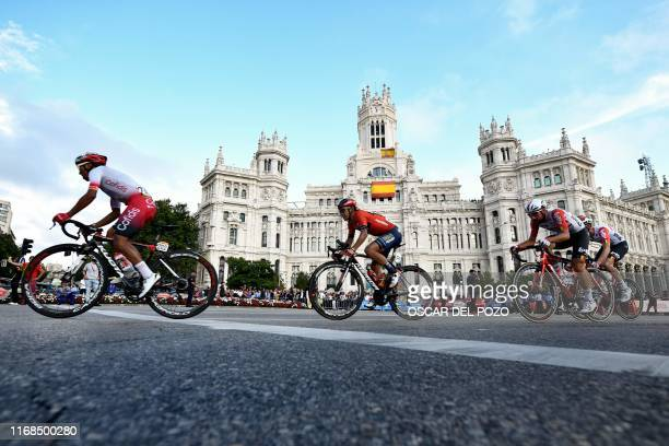 The pack rides past the Madrid city hall , during the 21st and last stage of the 2019 La Vuelta cycling Tour of Spain, a 106,6 km race from...