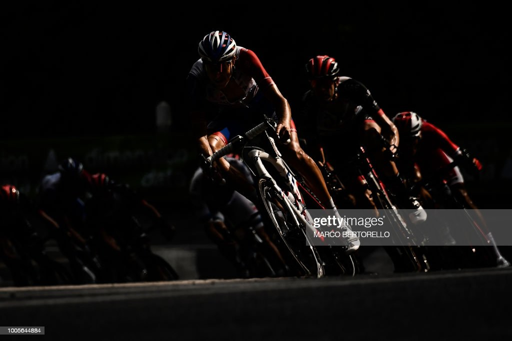 TOPSHOT - The pack rides through a bend, chasing a 5-men breakaway during the 18th stage of the 105th edition of the Tour de France cycling race, on July 26, 2018 between Trie-sur-Baise and Pau, southwestern France.