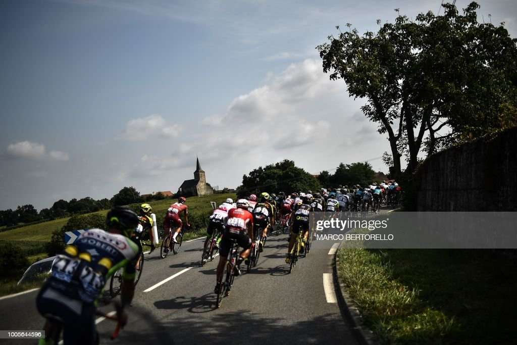 TOPSHOT - The pack rides through a bend during the 18th stage of the 105th edition of the Tour de France cycling race, on July 26, 2018 between Trie-sur-Baise and Pau, southwestern France.