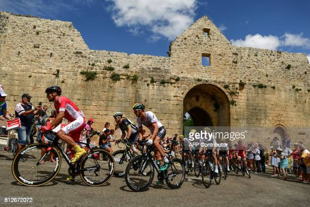 The pack rides through a rampart during the 178 km tenth stage of the 104th edition of the Tour de France cycling race on July 11, 2017 between...