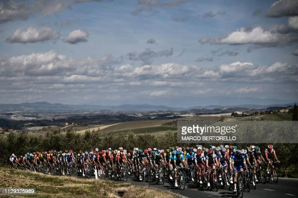 The pack rides through the countryside during the one-day classic cycling race Strade Bianche on March 9, 2019 around Siena, Tuscany.