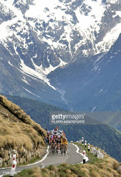 The pack rides through the mountains during the 20th stage of Giro D'Italia cycling tour from Trento to Aprica 27 May 2006Italy's Ivan Basso won the...