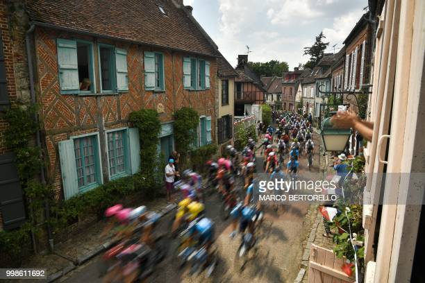 The pack rides through the village of Gerberoy during the eighth stage of the 105th edition of the Tour de France cycling race between Dreux and...
