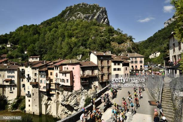 The pack rides through the village of PontenRoyans during the 13th stage of the 105th edition of the Tour de France cycling race between Le...