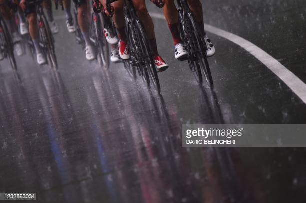 The pack rides under the rain during the sixth stage of the Giro d'Italia 2021 cycling race, 160 km between Grotte di Frasassi and Ascoli Piceno on...