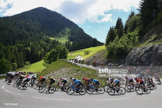 The pack takes a curve downhill during the eighth and last stage of the 71st edition of the Criterium du Dauphine cycling race 5 km between Cluses...