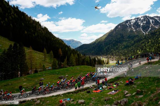 TOPSHOT The pack takes the ascent of the Manghen pass during stage twenty of the 102nd Giro d'Italia Tour of Italy cycle race 194kms from Feltre to...