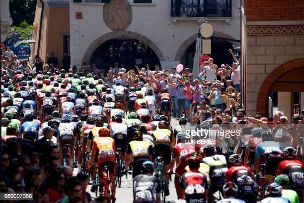 TOPSHOT The pack takes the start of the 20th stage of the 100th Giro d'Italia Tour of Italy from Pordenone to Asiago of 190 km on May 27 2017 in...