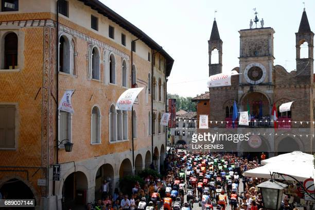 The pack takes the start of the 20th stage of the 100th Giro d'Italia Tour of Italy from Pordenone to Asiago of 190 km on May 27 2017 in Pordenone /...