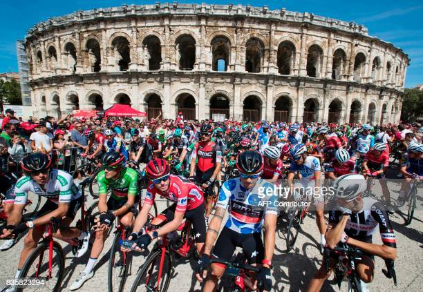TOPSHOT The pack wait in front of the Arena of Nimes prior to the start of the 2nd stage of the 72nd edition of La Vuelta Tour of Spain cycling race...